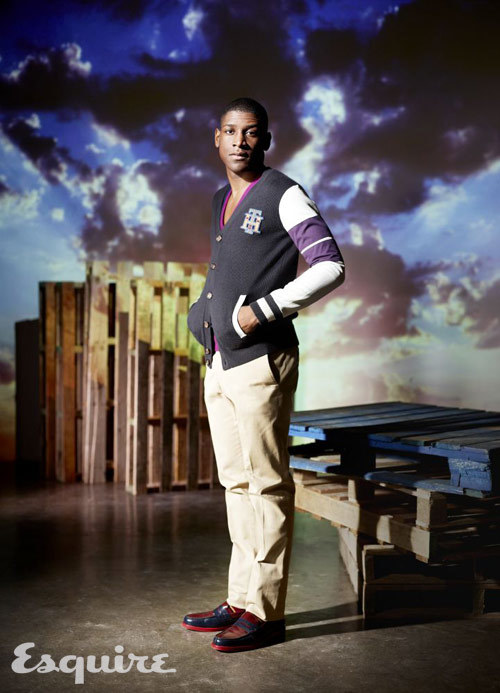 Musician Labrinth is wearing a varsity jacket